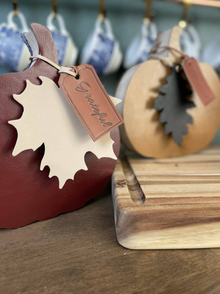 Leather and wood pumpkins with leave embellishments.